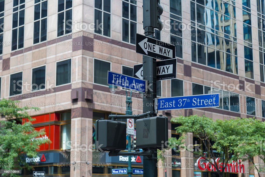 Signpost in Midtown Manhattan at 5 Ave and 37 St stock photo