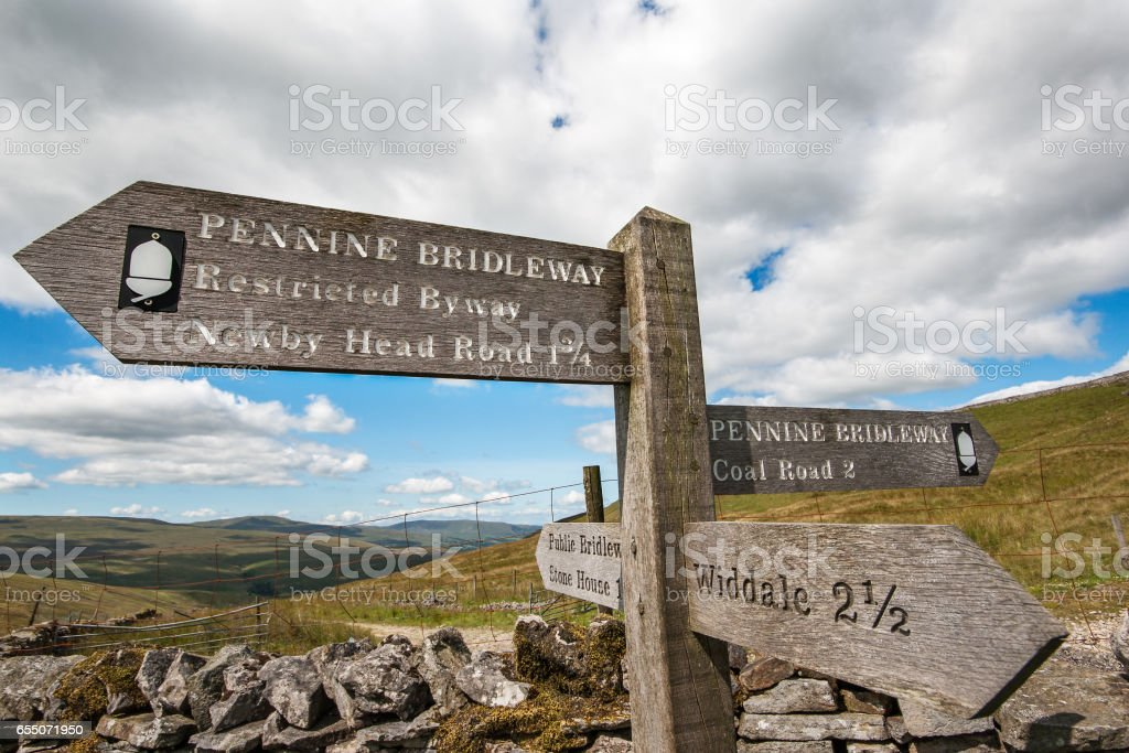 Signpost of distances on Pennine Bridleway Yorkshire UK stock photo