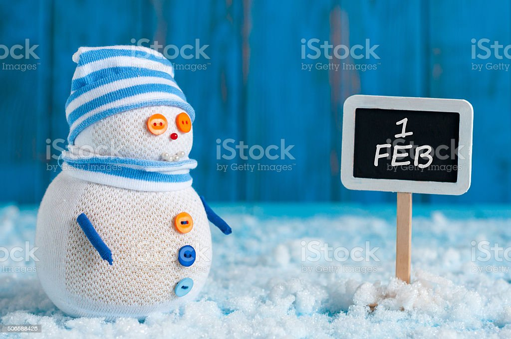 Signpost of the 1 February and Snowman  stand near direction stock photo