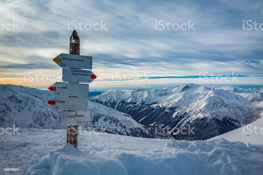 Signpost on mountain trail in winter, Kasprowy Wierch, Tatra Mountains stock photo