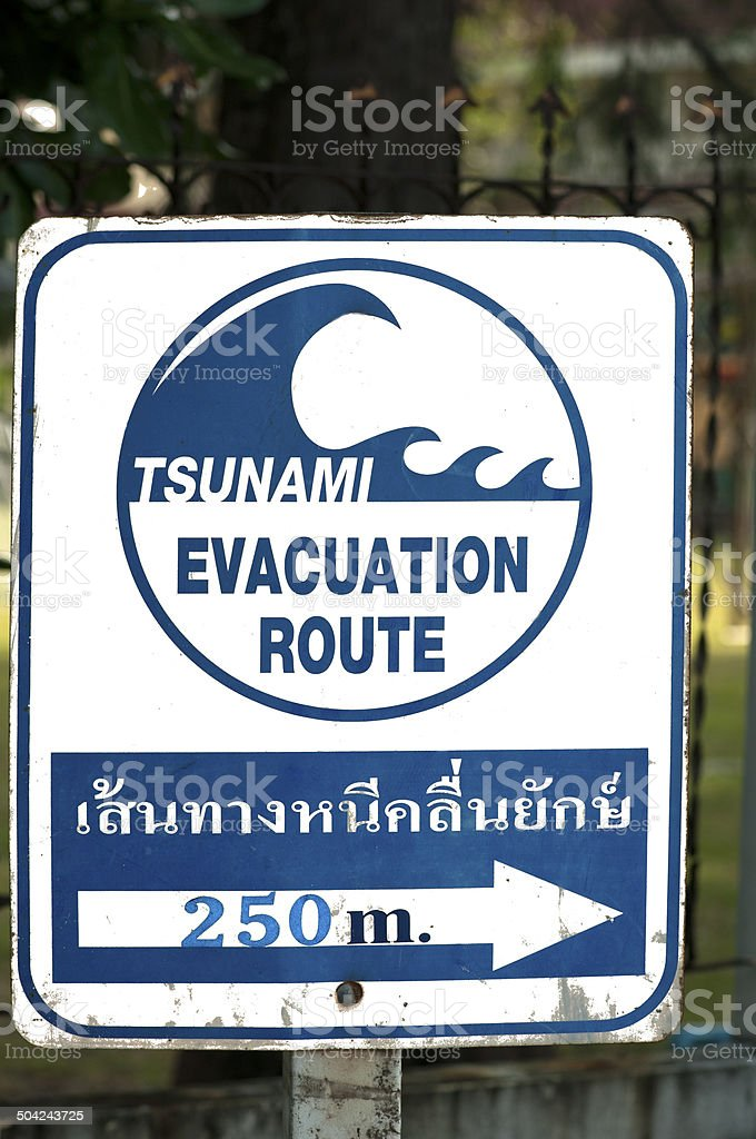 Signpost pointing to a tsunami shelter stock photo
