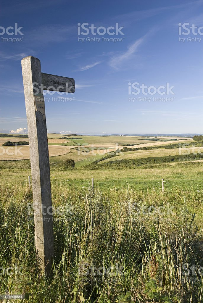Signpost points to path across the downs royalty-free stock photo