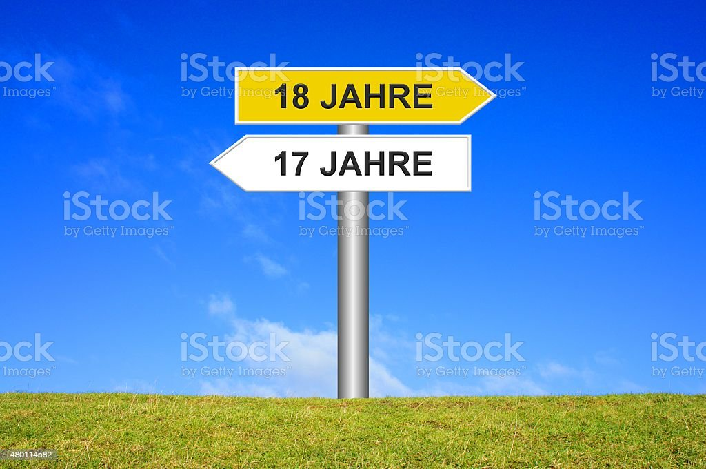 Signpost showing 17 years or 18 years in german stock photo