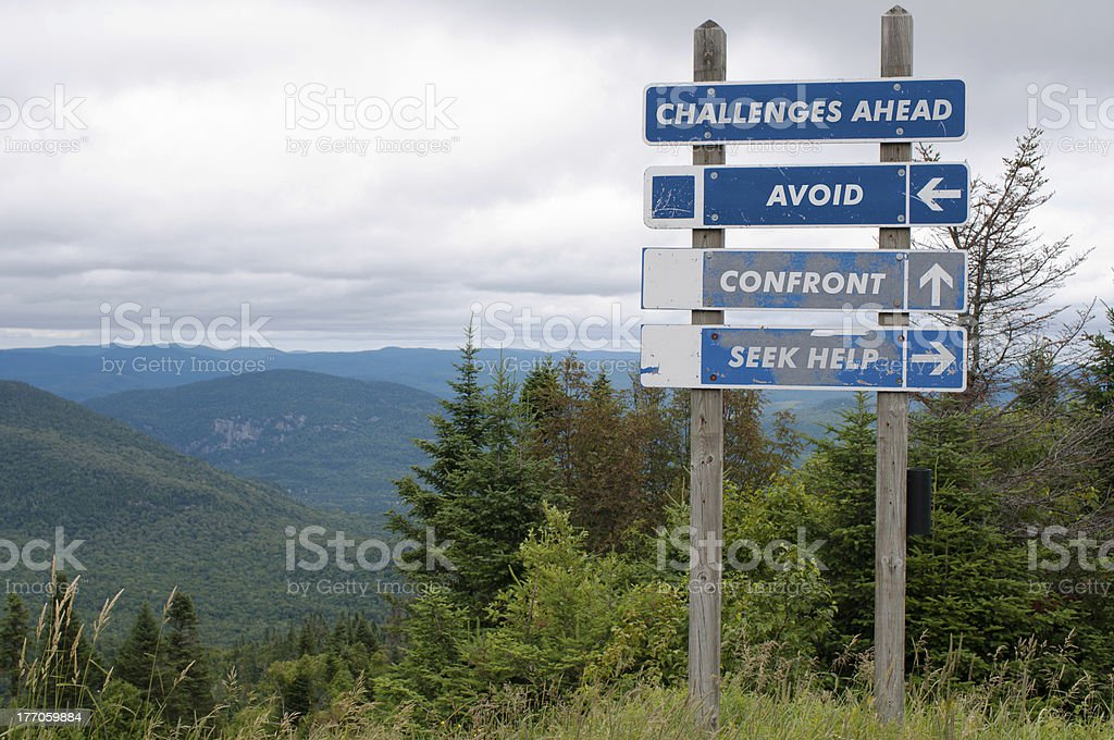 Signpost showing challenges ahead and three options stock photo