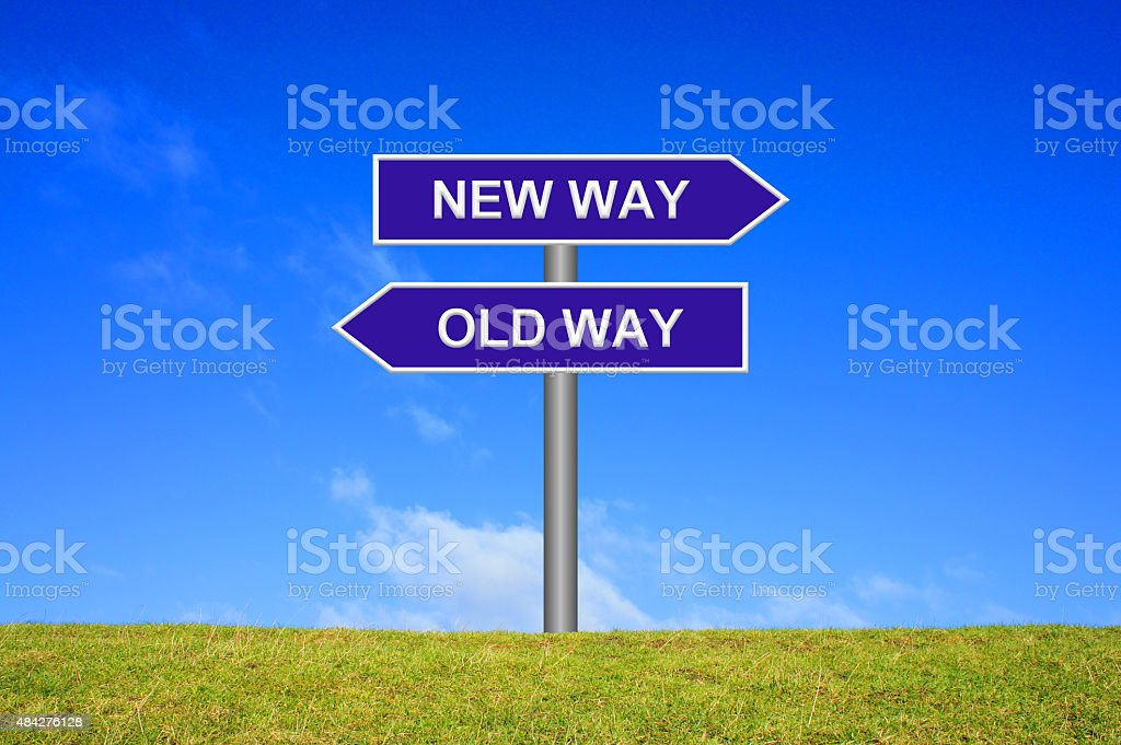 Signpost showing new way old way stock photo