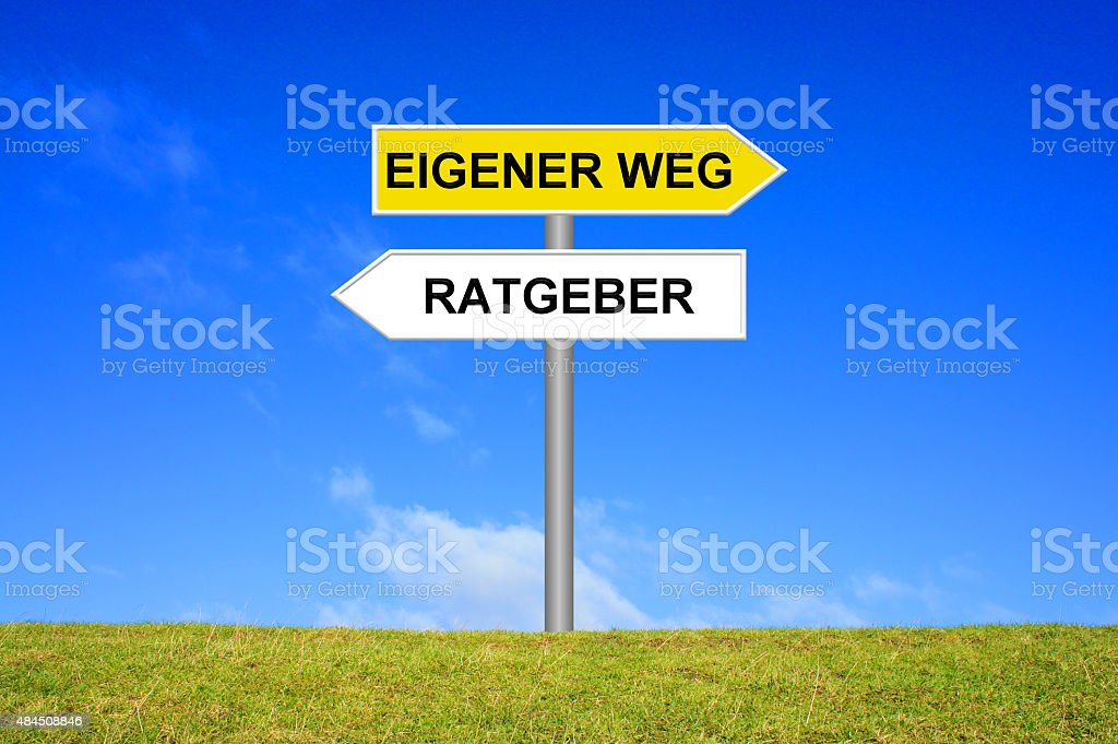 Signpost showing own way or counselor german stock photo
