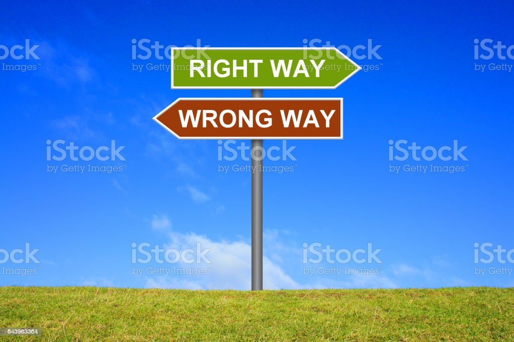 Signpost showing Right or Wrong Way stock photo
