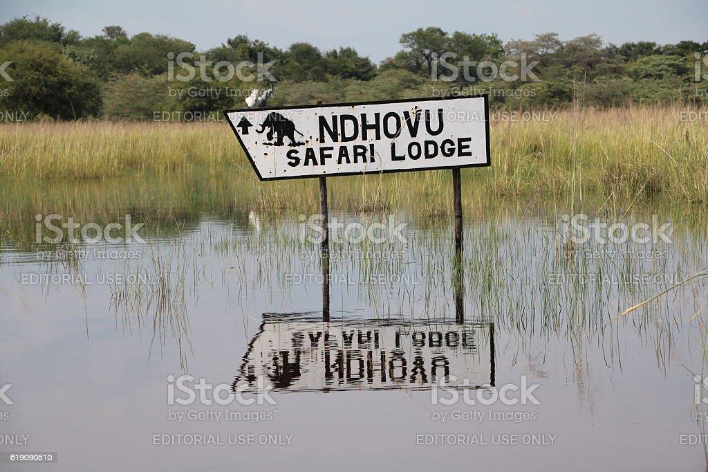 Signpost to NDHOVU Safari Lodge stock photo