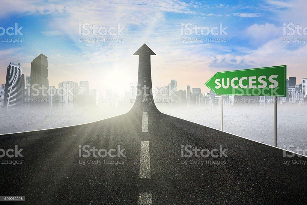 Signpost to success on the street upward stock photo