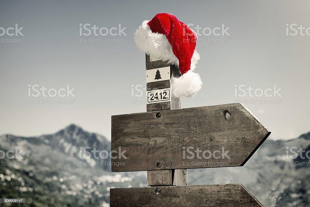 Signpost with Santa Hat stock photo