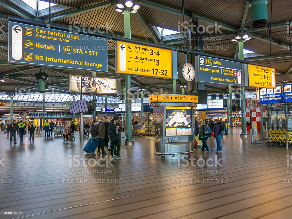 Signs and people at Schiphol Amsterdam Airport stock photo