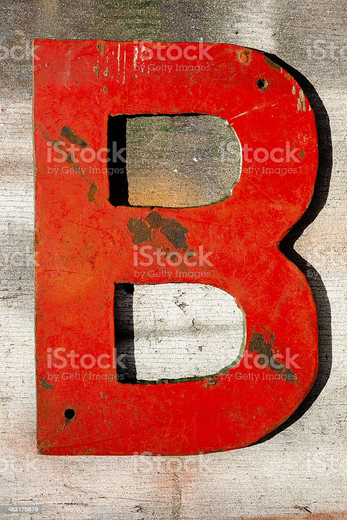 Signs: Capital letter 'B' on wooden, grunge plank. stock photo