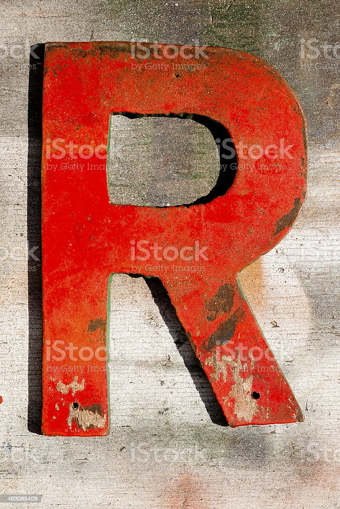 Signs: Capital letter 'R' on wooden, grunge plank. stock photo