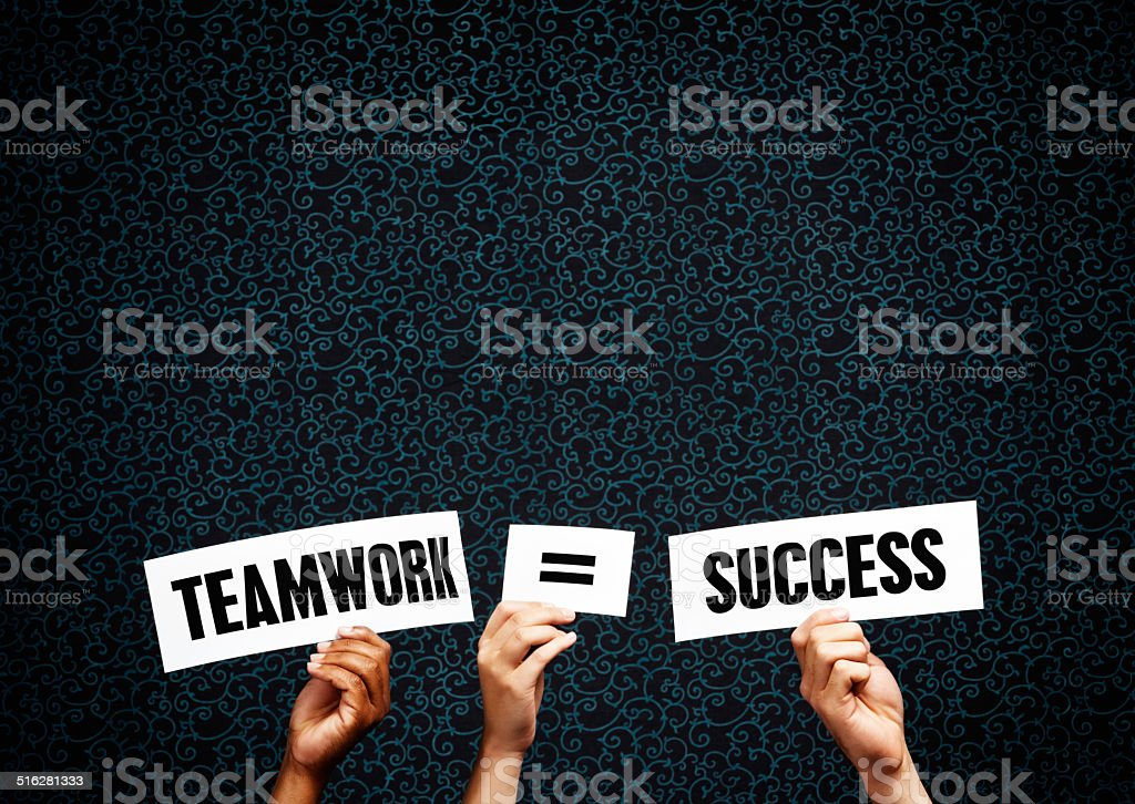 Signs claim 'Teamwork = Success'. It's true! stock photo