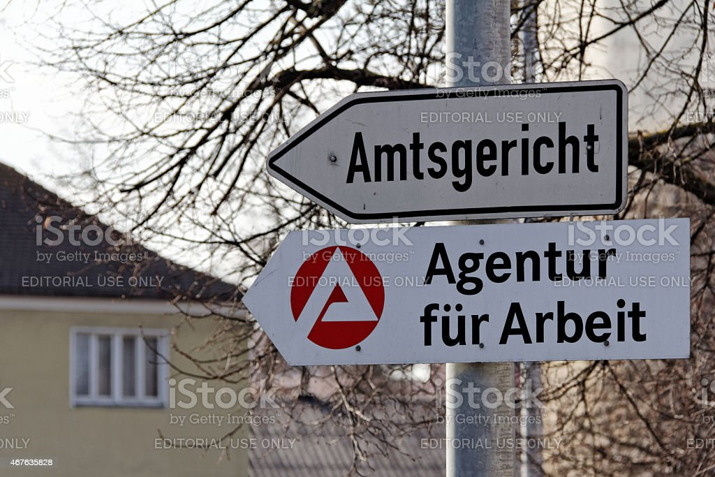 signs to Agentur fuer Arbeit and Amtsgericht stock photo
