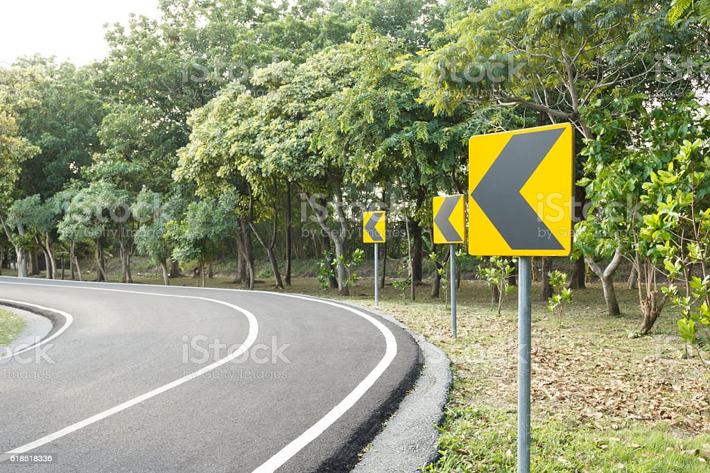 Signs warning turn left of the curve road stock photo