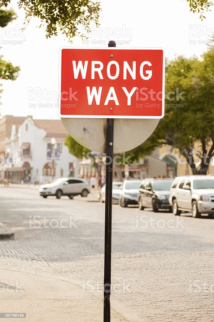 Signs: 'Wrong Way' sign on downtown city street. royalty-free stock photo