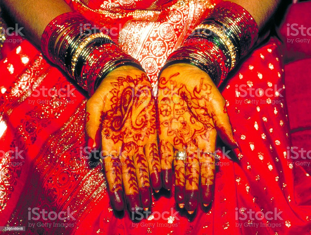Sikh bride's hands covered with hena royalty-free stock photo