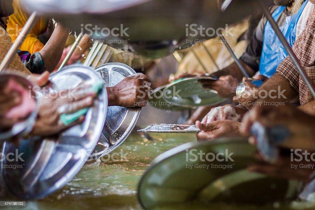 Sikh devotees performing bartan seva at Golden temple, Amritsar stock photo