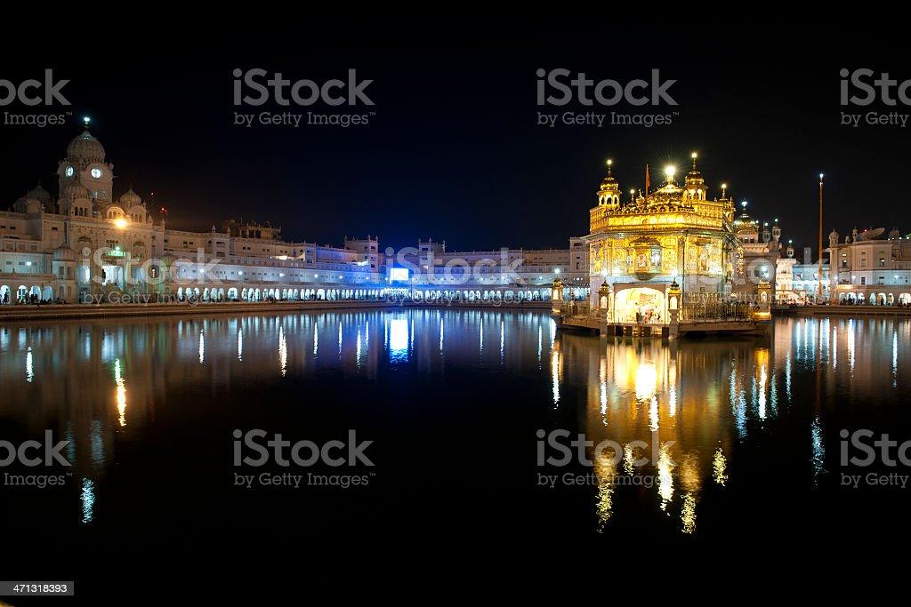 Sikh Golden Temple at Night Amritsar stock photo
