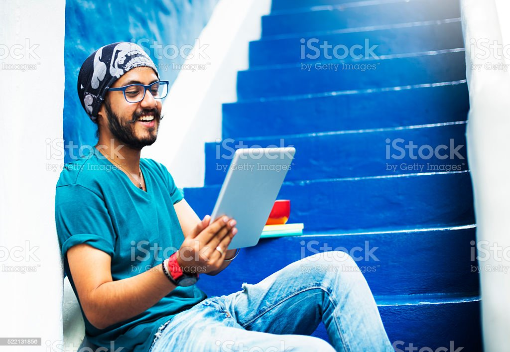 Sikh Guy Browsing Tablet Stair Case Concept stock photo