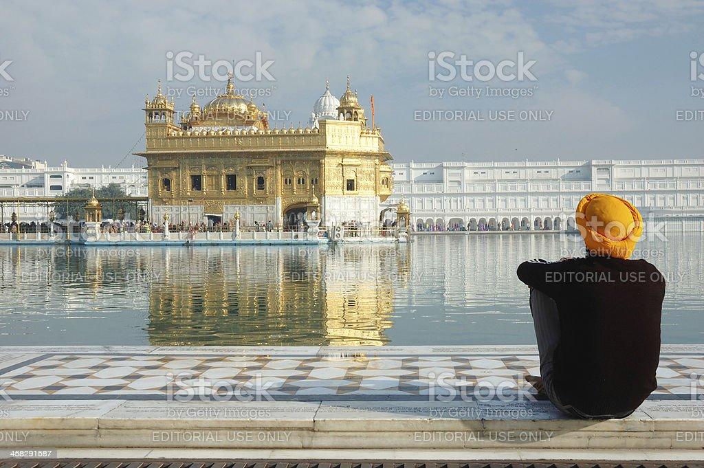 Sikh in orange turban meditating inside Golden Temple,Amritsar stock photo