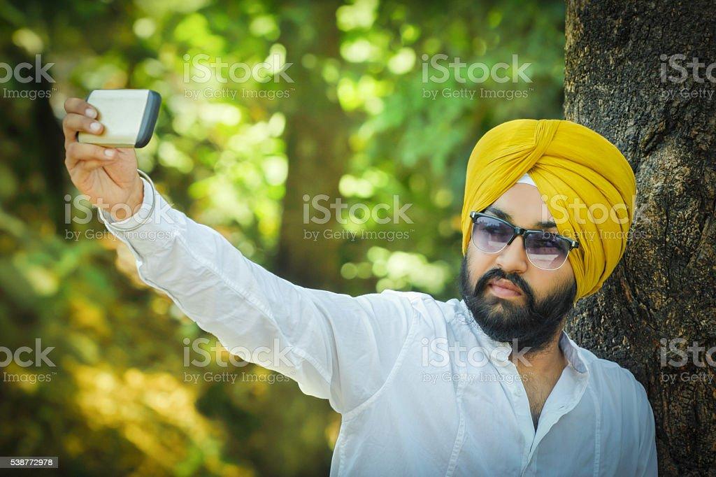 Sikh man taking a selfie stock photo