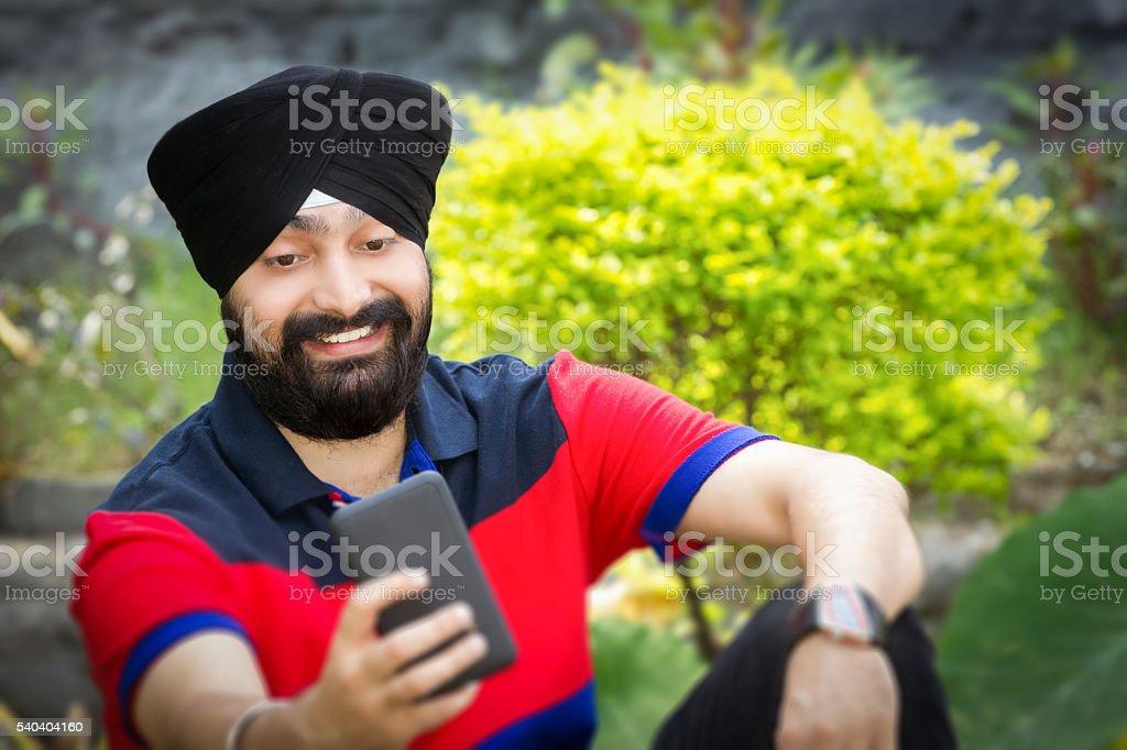 Sikh man taking a selfie. stock photo