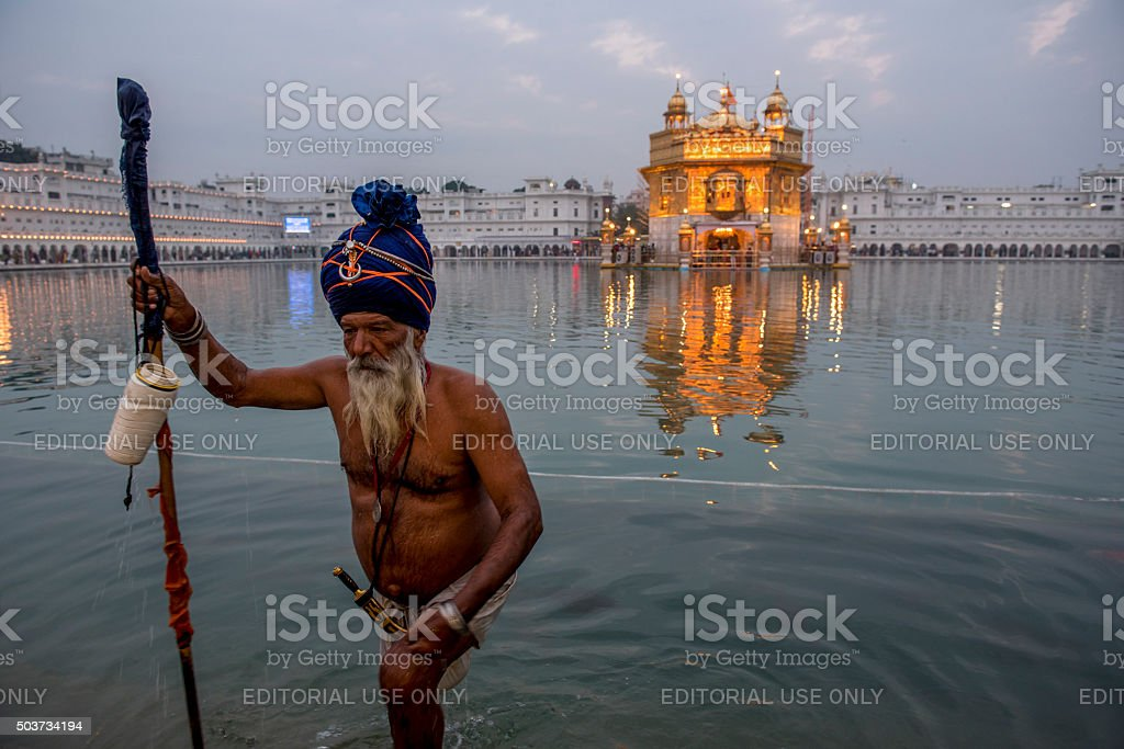 Sikh Man walking out of pool of Golden Temple, India stock photo