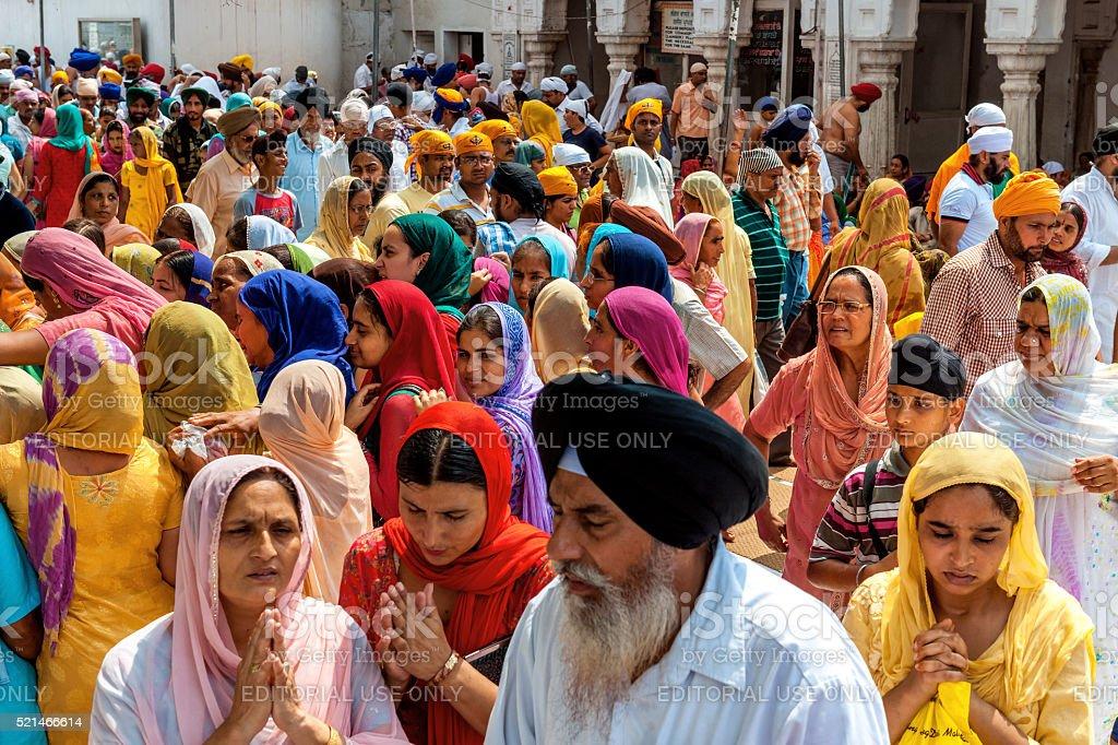 Sikh Pilgrims in Golden Temple Amritsar, India stock photo