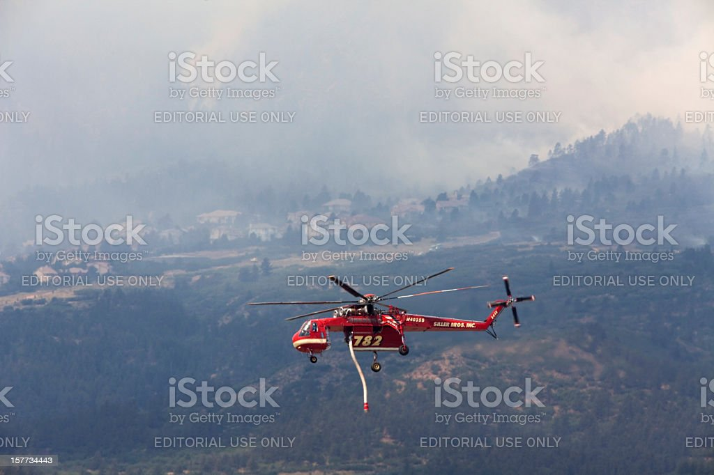 Sikorsky helicopter over Colorado Springs fire stock photo