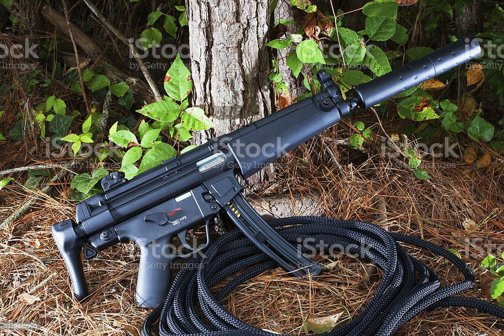 Silenced rifle stock photo