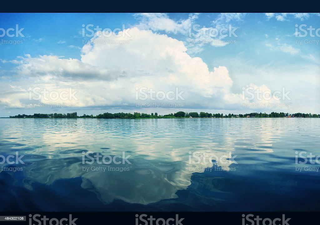 Silent lake near green forest. relaxing on the beach stock photo