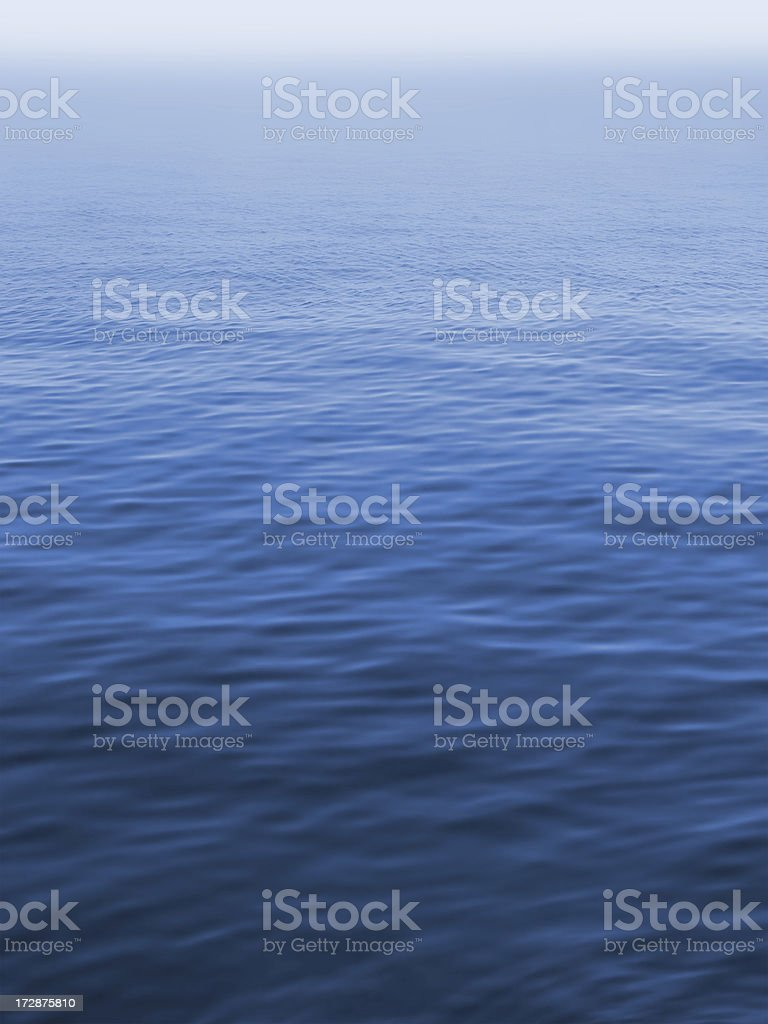 silent misty sea, blue water surface with small waves royalty-free stock photo