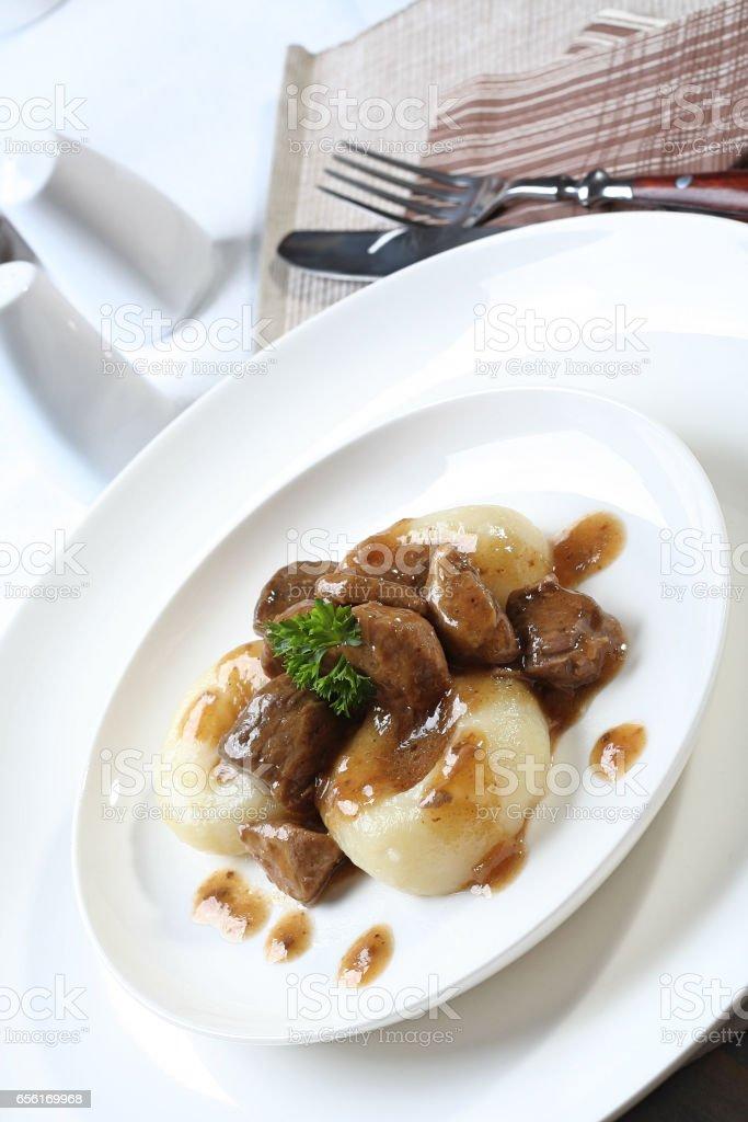 Silesian dumplings on white plate stock photo