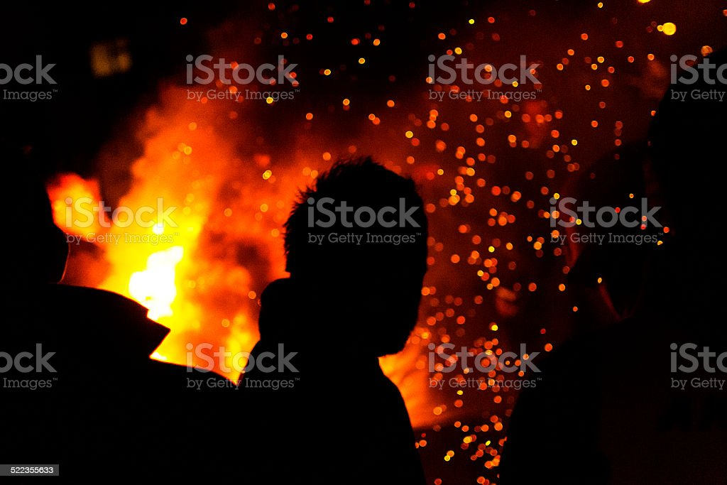 Silhouette against fire stock photo