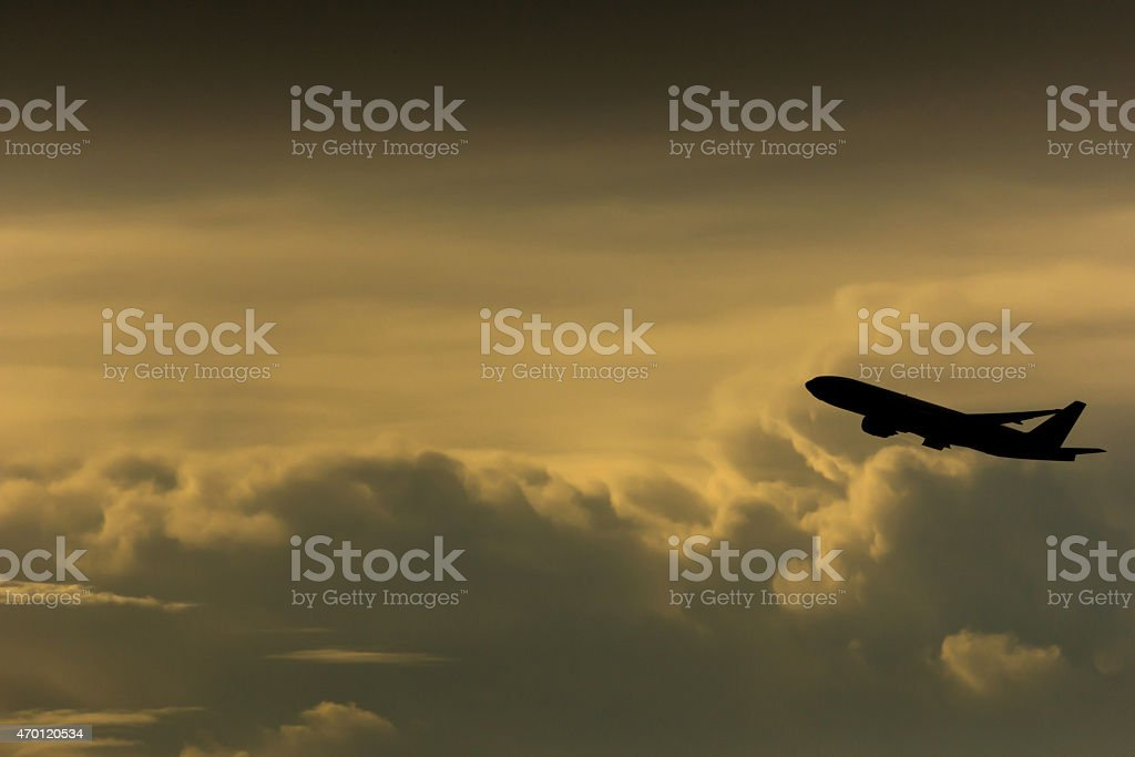 Silhouette airplane in the sky stock photo