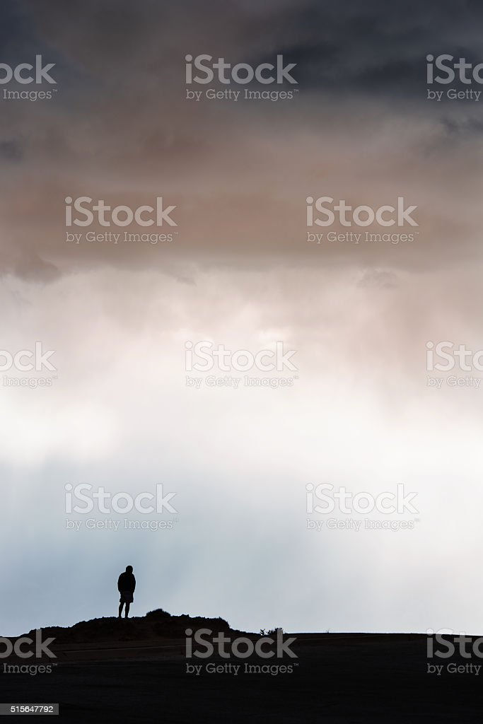 Silhouette Along A Cliff Looking At View stock photo