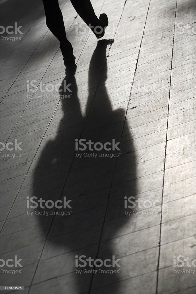 silhouette and shadow of a man on his way royalty-free stock photo