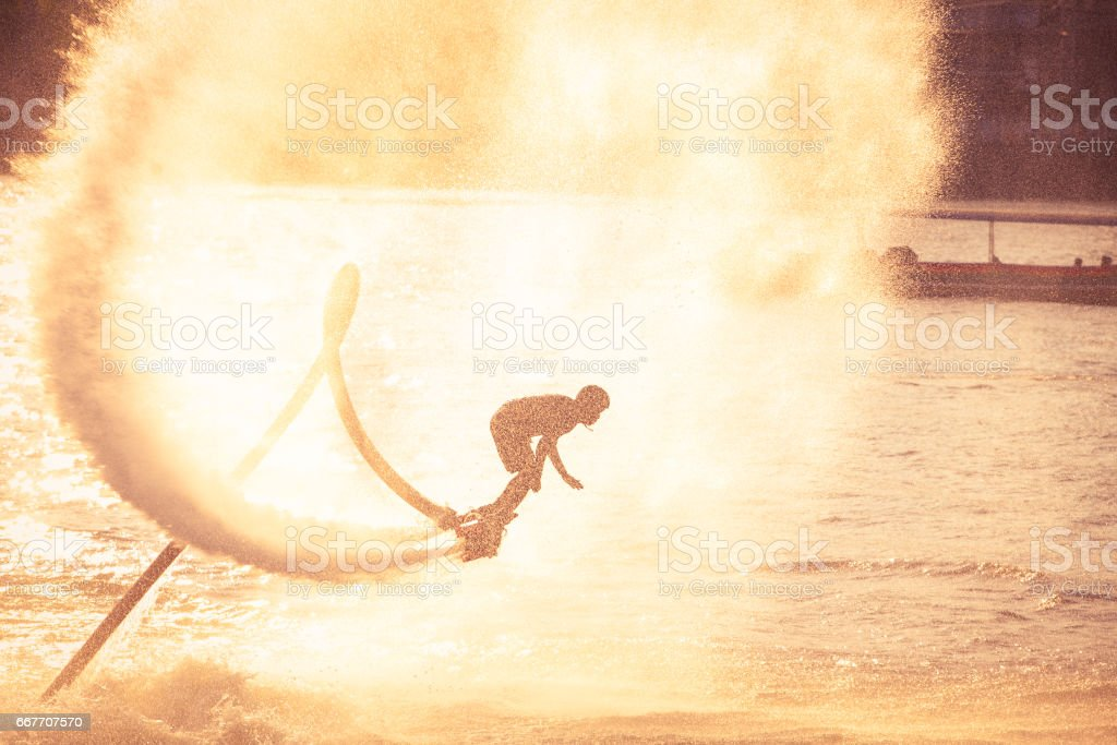 Silhouette and vintage color styl showing jetpack on Chaophya river stock photo