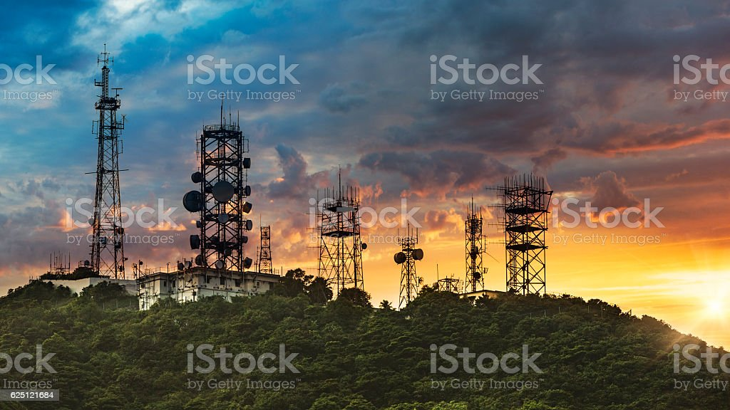 Silhouette Antenna towe with sunset background stock photo