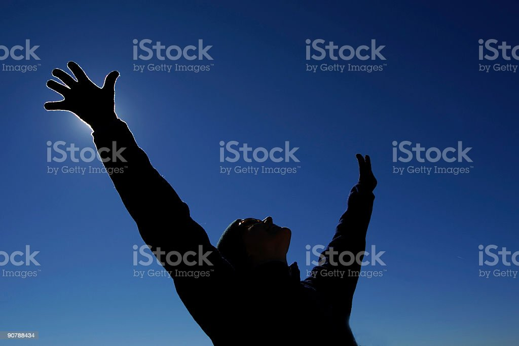 silhouette arms raised into clear blue sky royalty-free stock photo