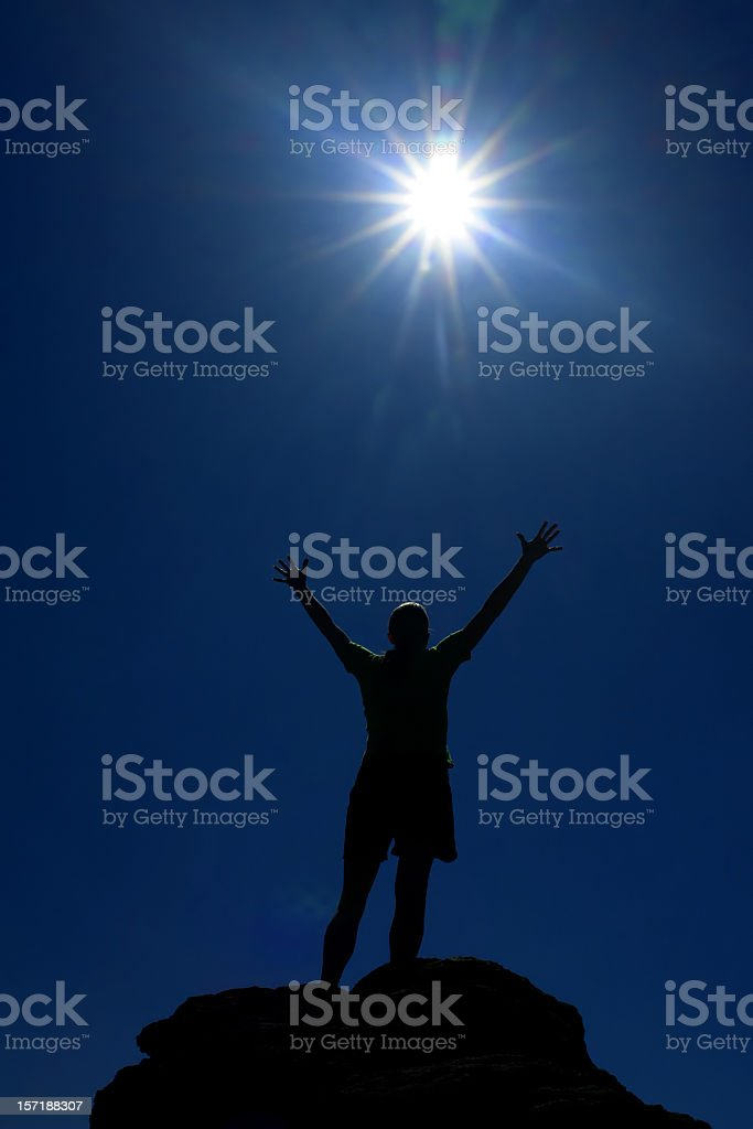 silhouette arms raised into sun sky royalty-free stock photo