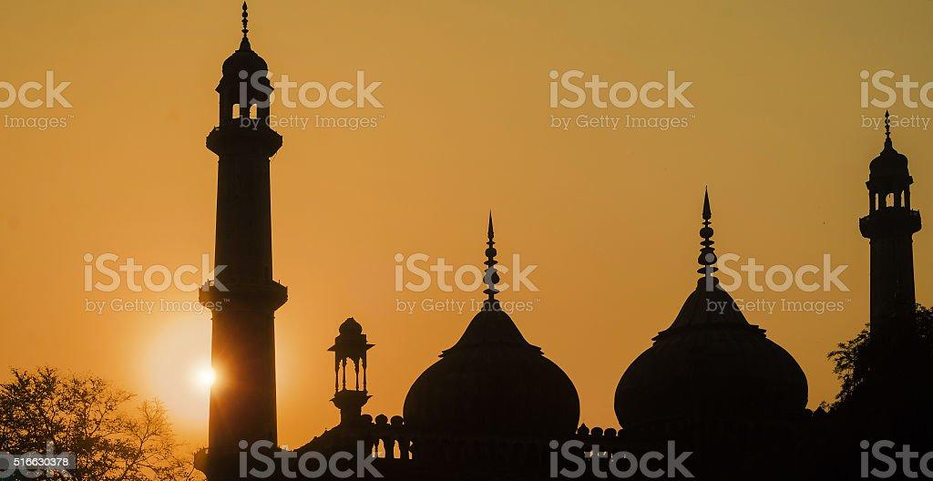 Silhouette - Asafi Masjid stock photo