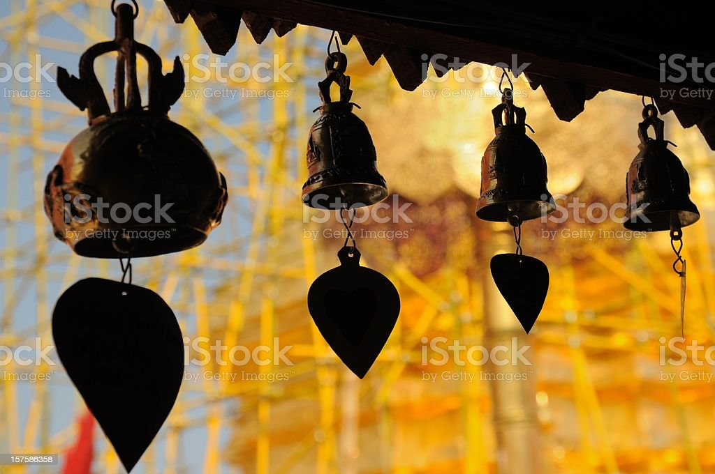Silhouette bells in yellow temple ( Wat ) stock photo