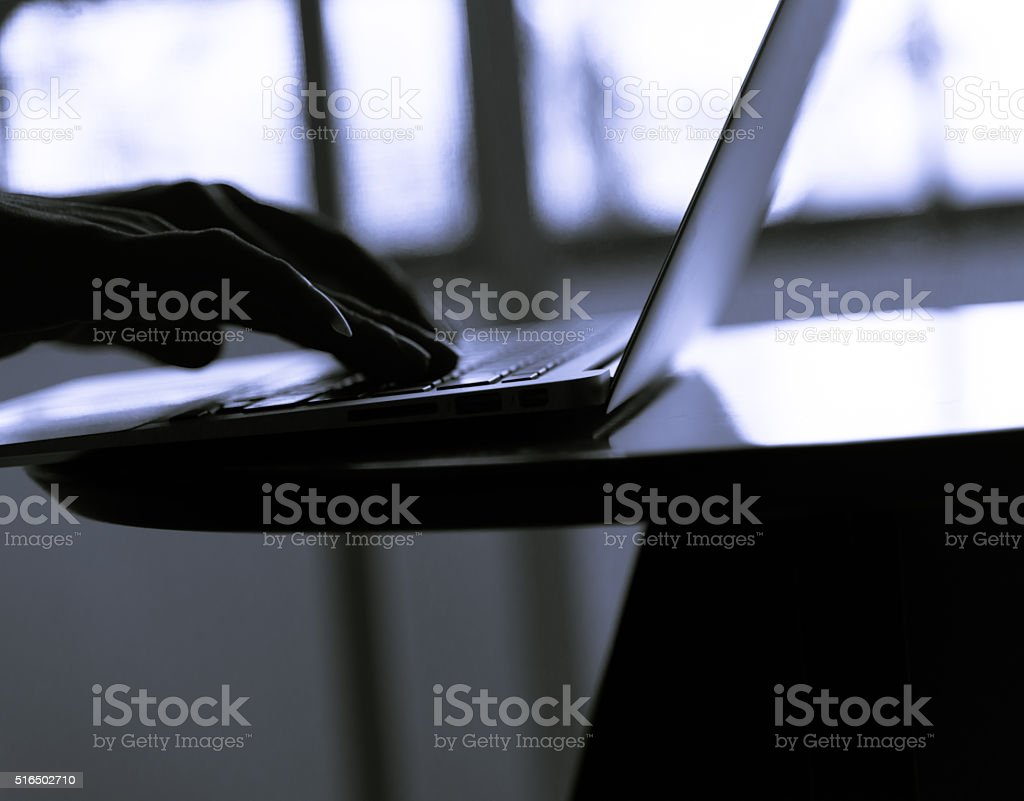 Silhouette blur  of human hand  use slim notebook stock photo