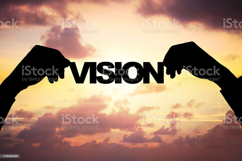 Silhouette Businessman's Hands Holding Vision During Sunset stock photo