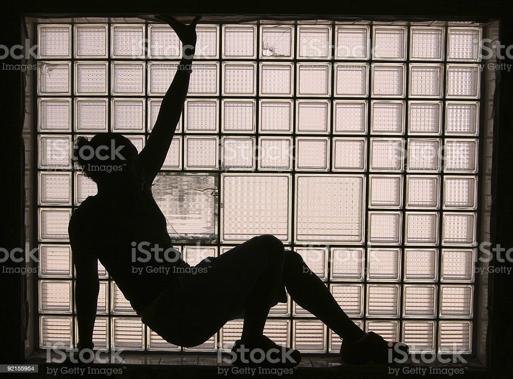 silhouette by window light stock photo