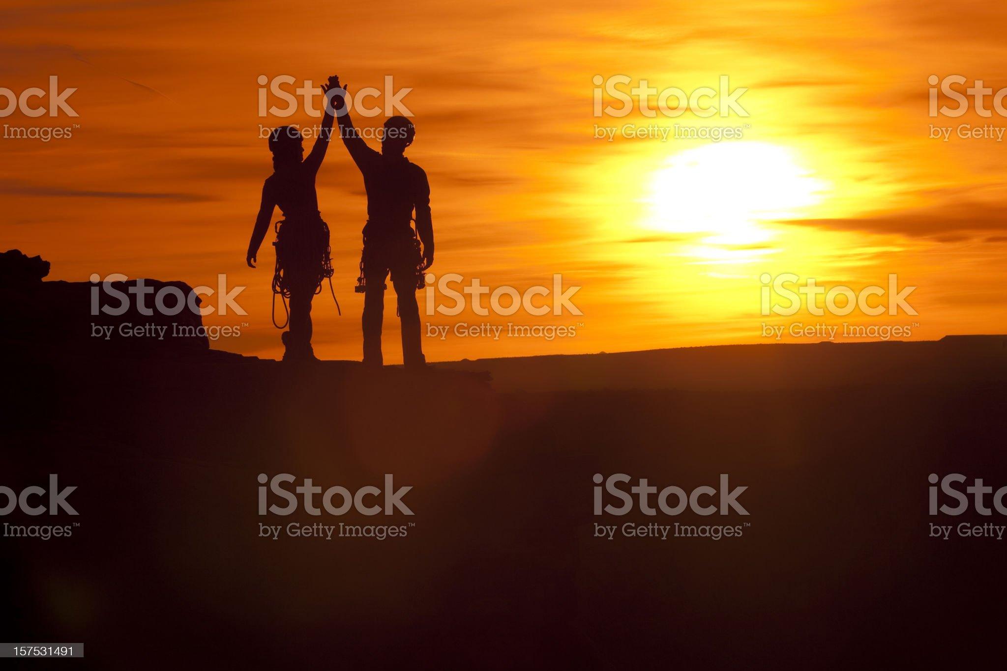 Silhouette Climbers royalty-free stock photo