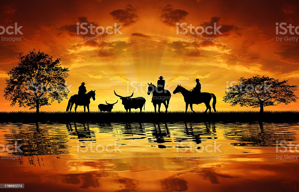 Silhouette cowboys with horses royalty-free stock photo